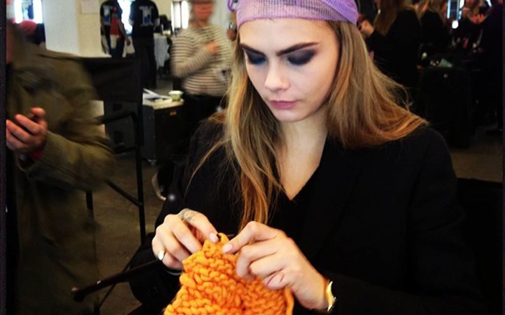 Surprise marketplace niches in the craft world show xposurephotos photo of Cara Delevigne knitting